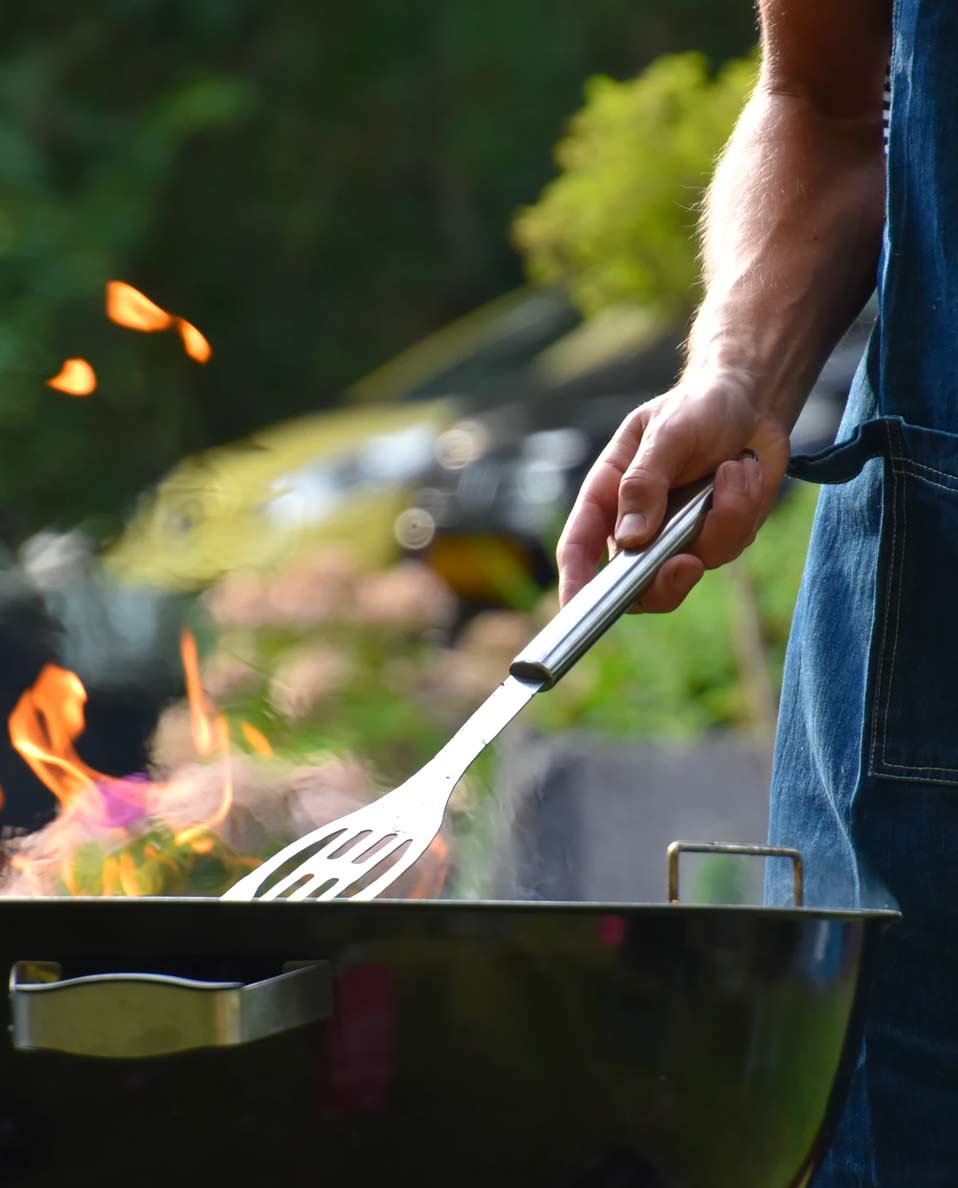 guy cooking on the grill