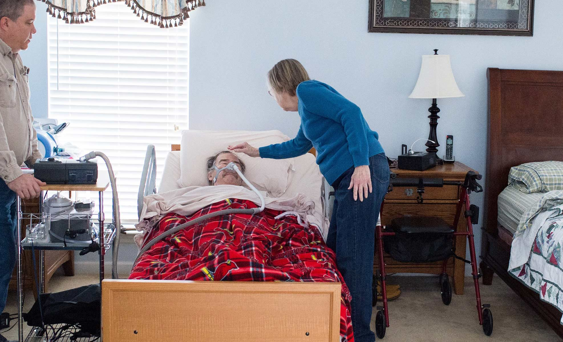 volunteer providing care for ALS patient