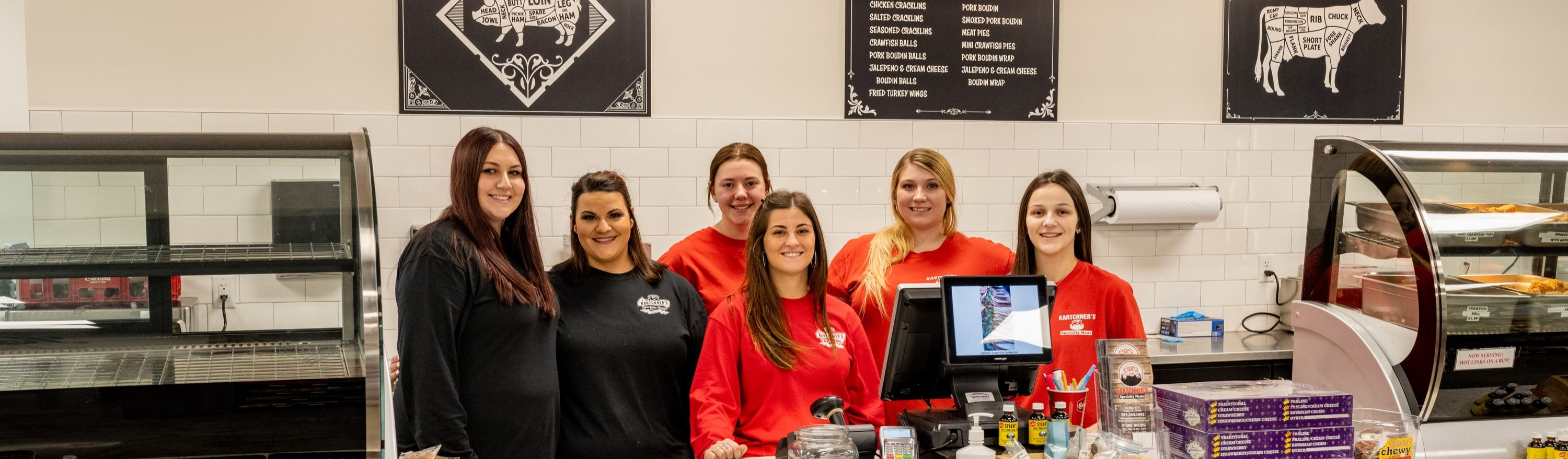 Kartchner's employees grouped behind the counter