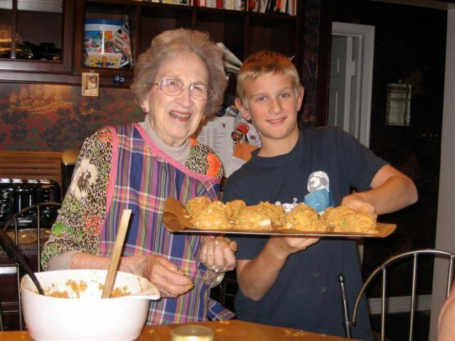 Older woman and young man holding food
