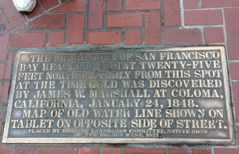 NO. 83 SHORELINE MARKERS - Plaque on SW corner of Market and Bush.