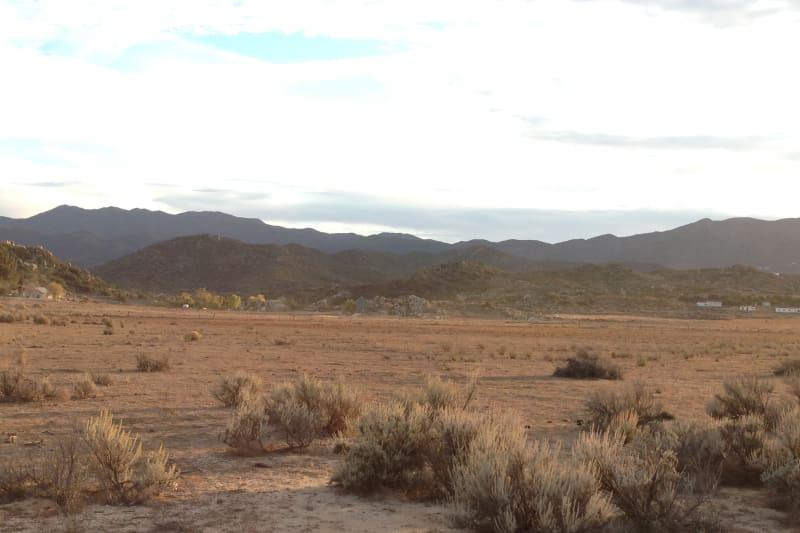 NO. 1O3 SITE OF DE ANZA CAMP _ Plaque located in background rocks.