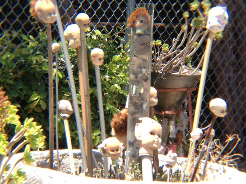 NO. 939  GRANDMA PRISBREY'S BOTTLE VILLAGE - Doll Heads