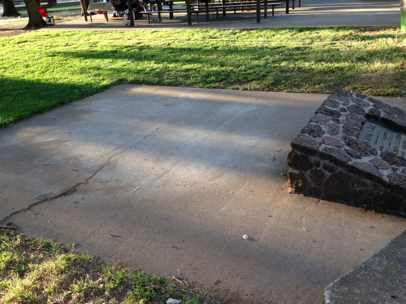 After vandals burned the stump, everything was removed and paved with cement.