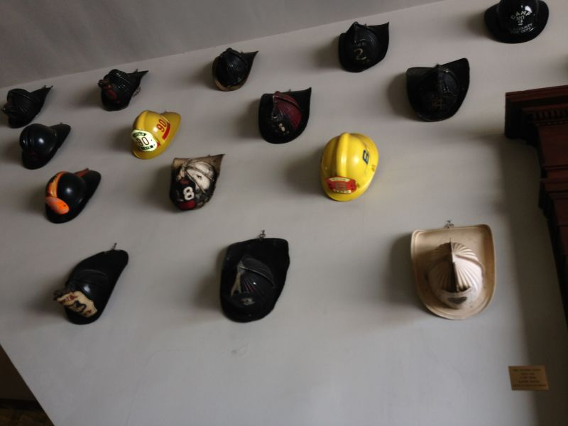 NO. 730 OLD PLAZA FIREHOUSE -Collection of Fireman Helmets
