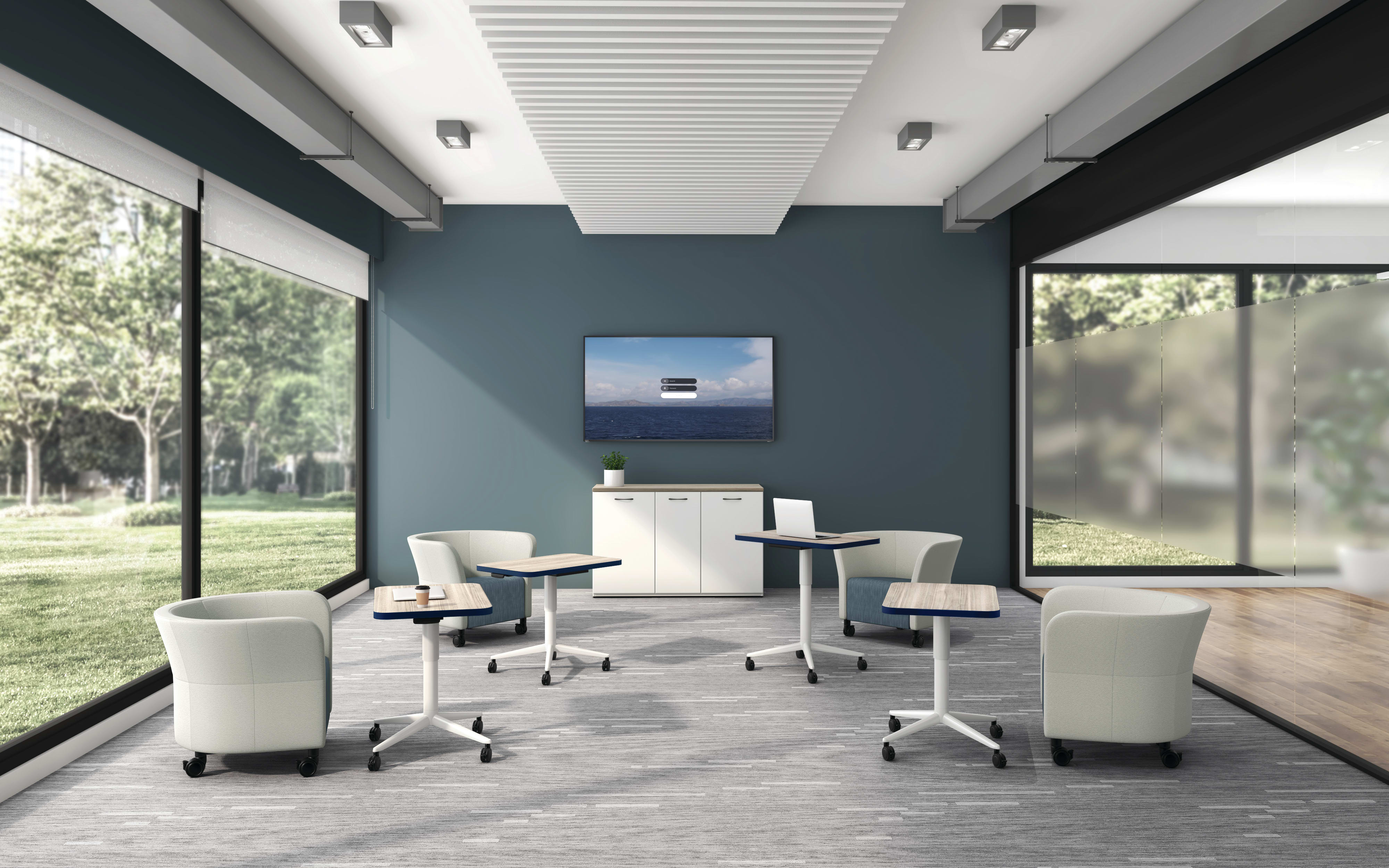 Huddle Laptop Tables with Flock Round Lounge Chairs socially distanced around a conference room.