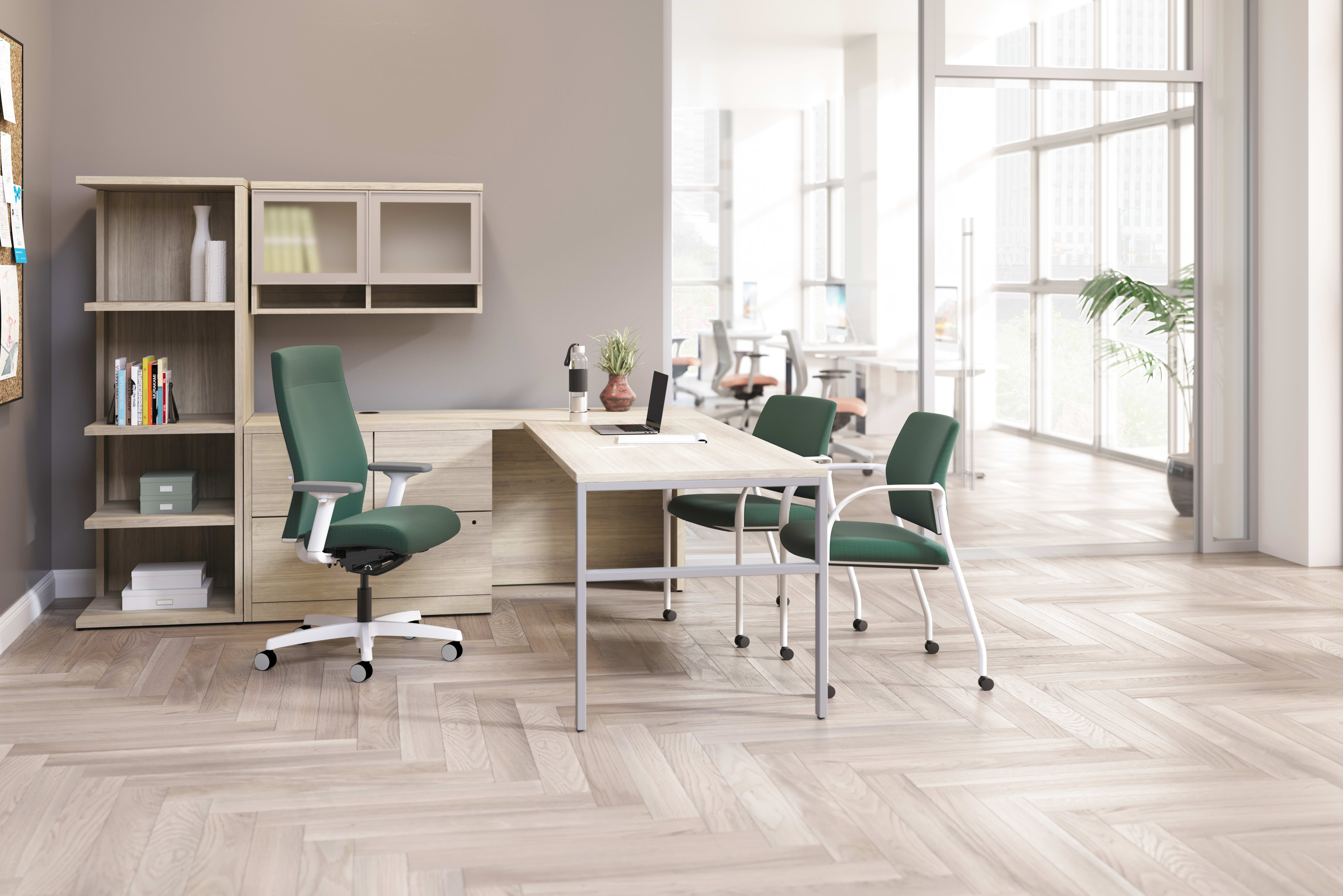 Ignition upholstered chair at 10500 Series L-shaped desk with 2 guest chairs.