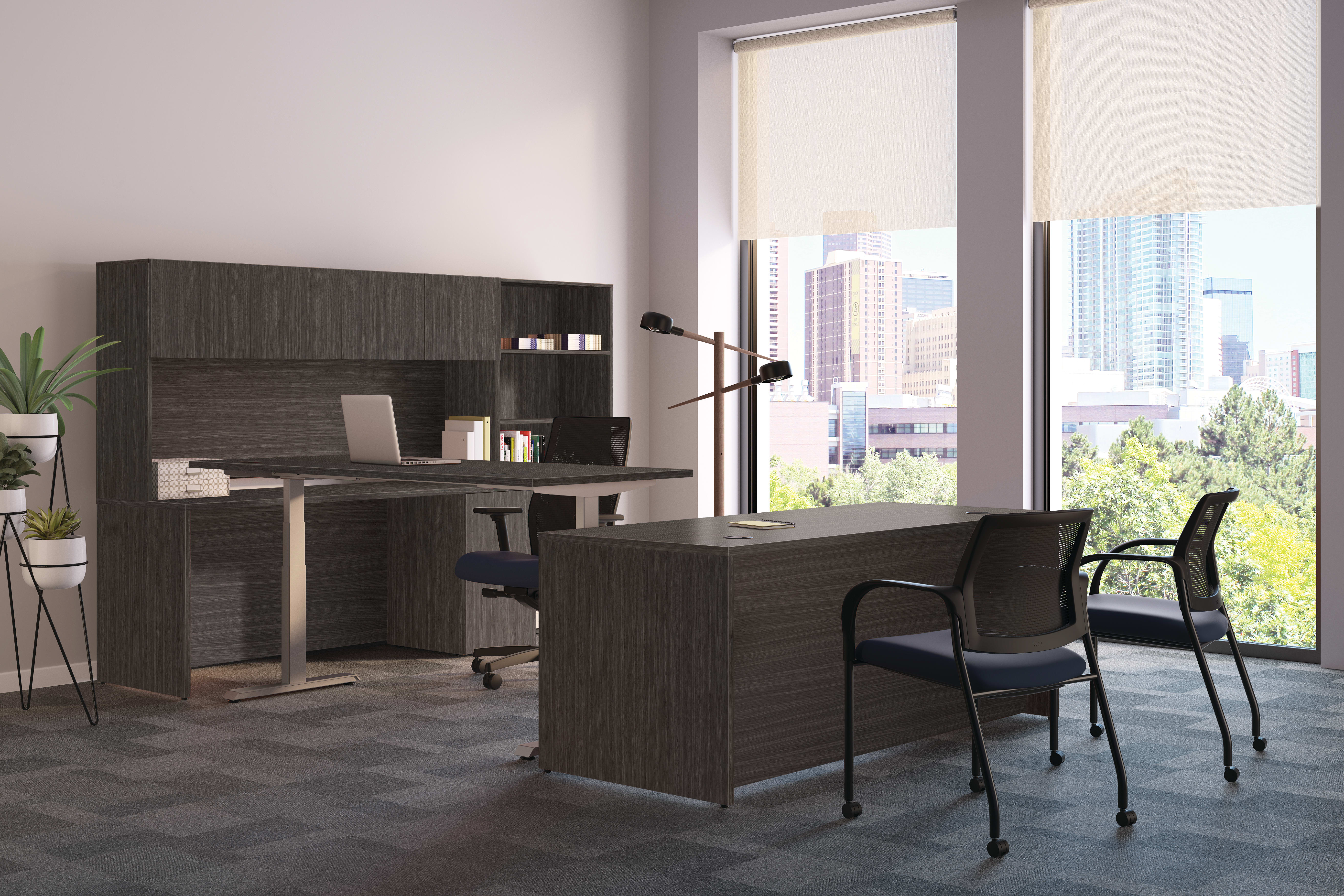 Mod desk with height-adjustable table and guest seating.