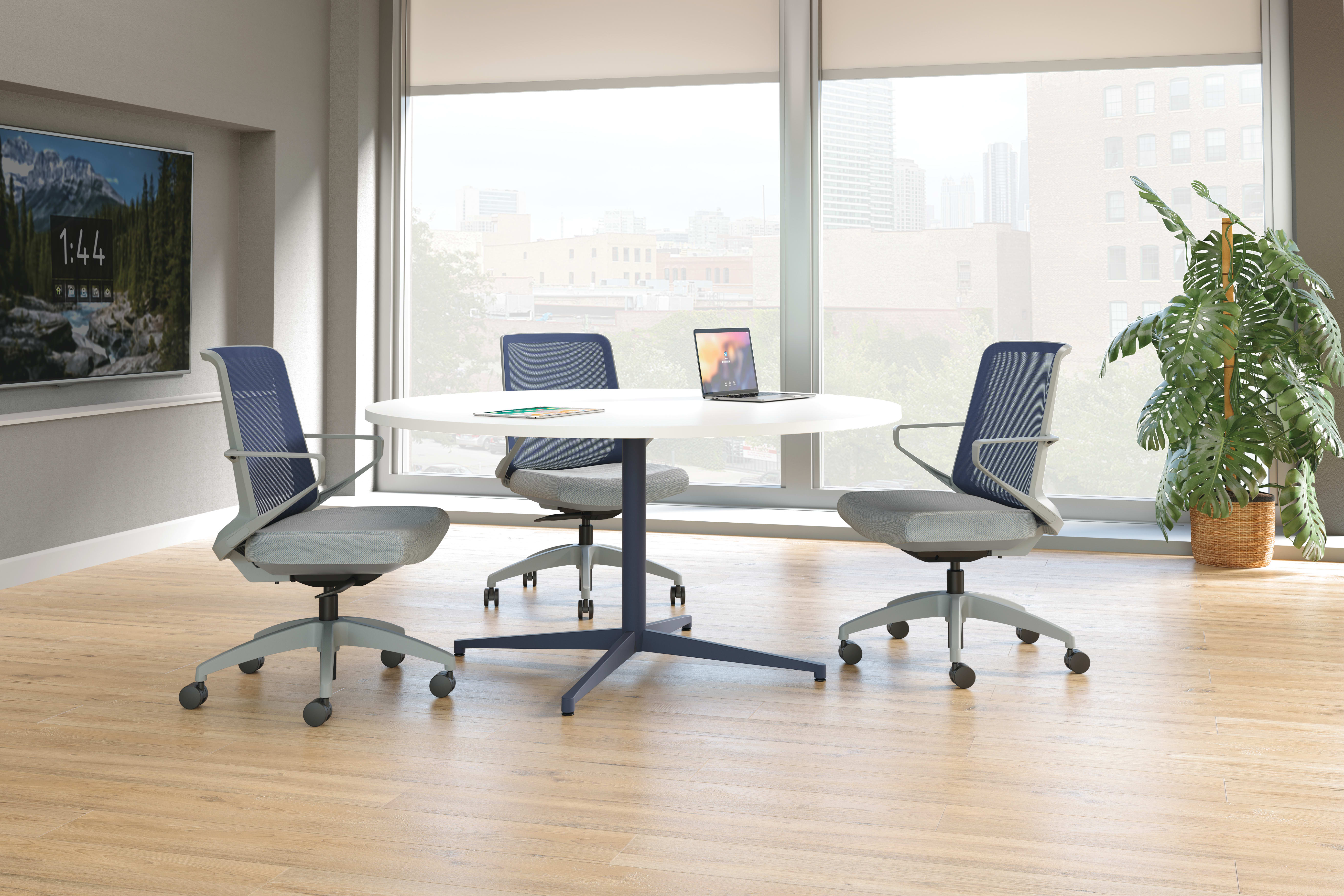 Cliq chairs with Preside round conference table.