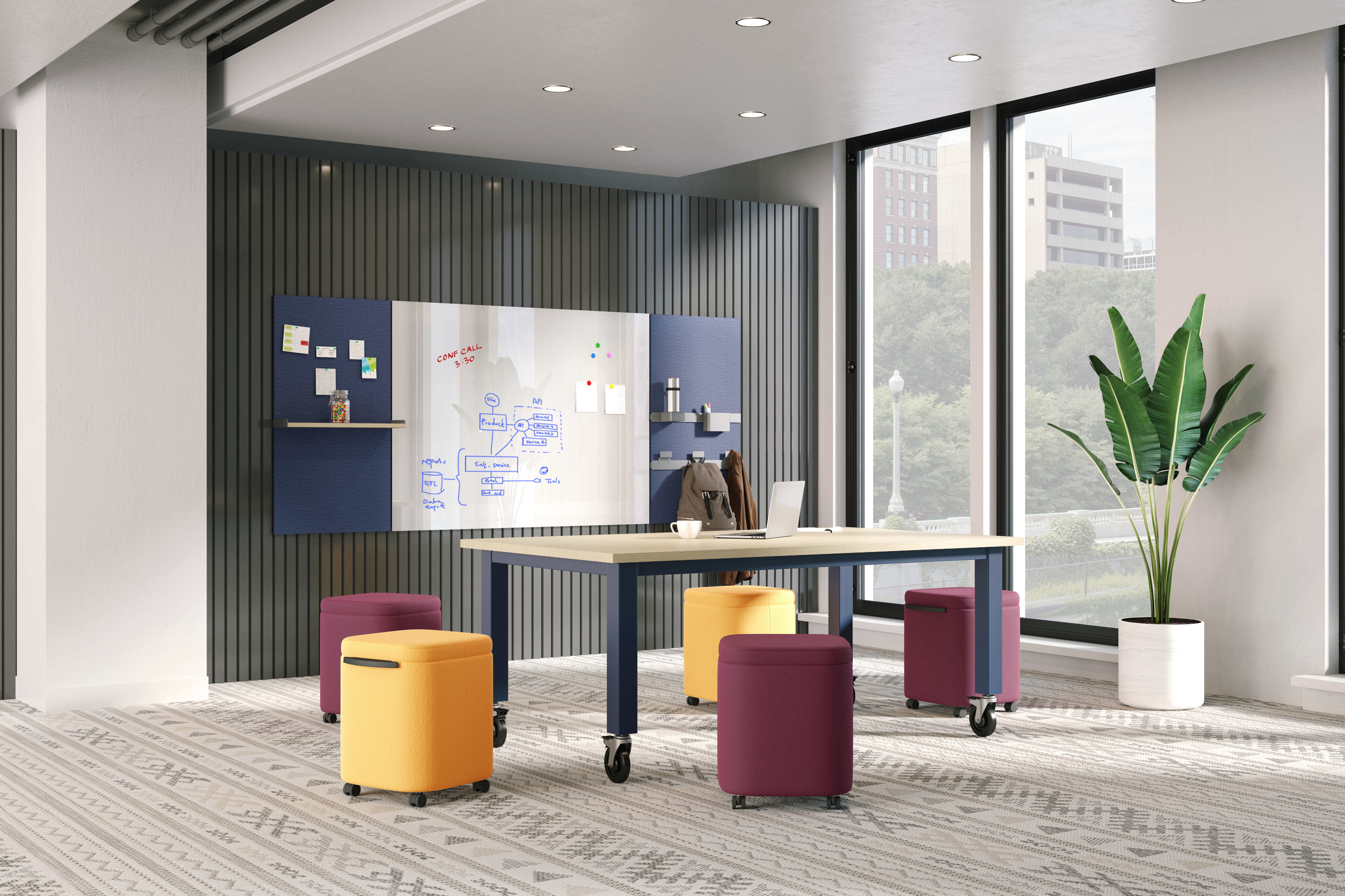 Preside table with Astir poufs with Workwall tiles in open collaborative setting