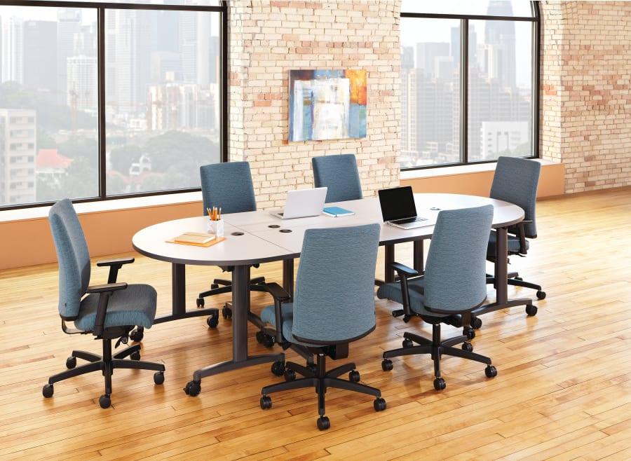 small elliptical-shaped desk in open office