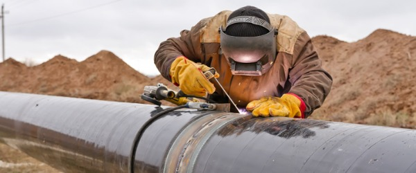 A welder working on a gas pipline.