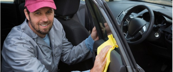 A Vehicle Cleaner uses specific cleaning products to remove stains and dirt from their customer's vehicles.