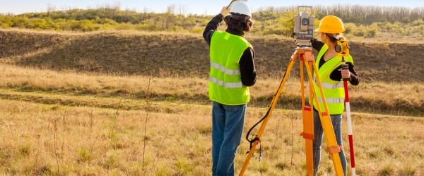A surveyor establishes official land, airspace, and water boundaries by measuring distances, directions, and angles between points on, above, and below the earth's surface.