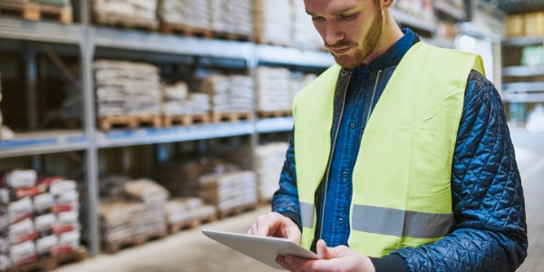 A stock clerk unpacks new merchandise that has arrived in the warehouse, checks for any damage or mislabeling, and gets it to where it needs to be stocked.