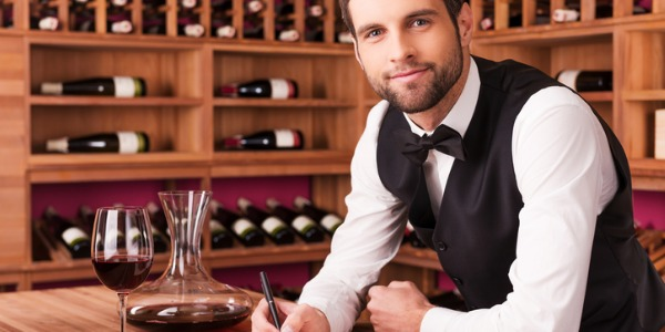 A sommelier or wine steward is an expert in fine wine and is responsible for serving it to patrons.