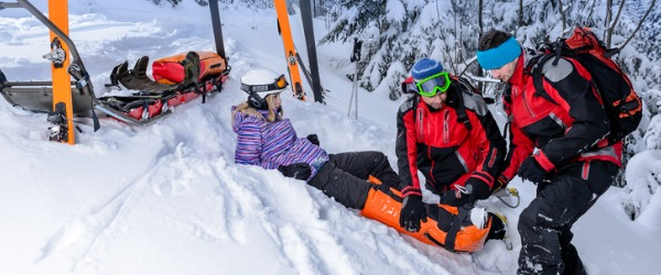 A ski patroller provides emergency medical care and rescue services to patrons of a ski resort, or in a back country area.