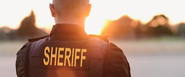 A sheriff is typically the top law enforcement officer of a county, and an elected county official.