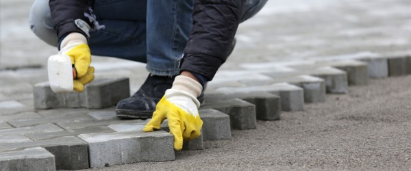 A segmental paver is a construction and home renovation specialist who installs flat segments of brick, concrete, or other stone-like building materials.