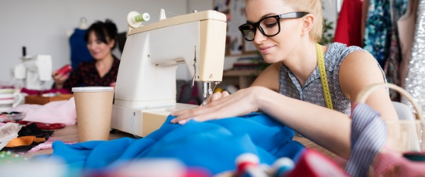Seamstresses serve their local community with sewing services, typically working in a small independent shop where customers come in to have garments repaired or altered.