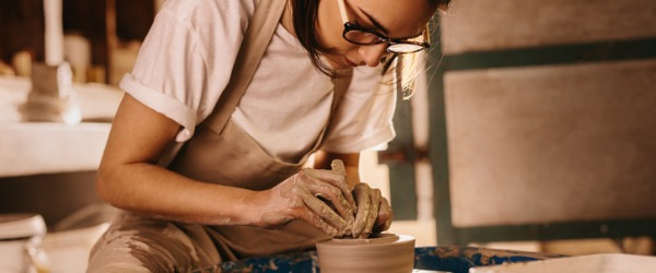 A potter uses their artistic talents to create pots, dishes, mugs, vases, and other types of artwork from clay.