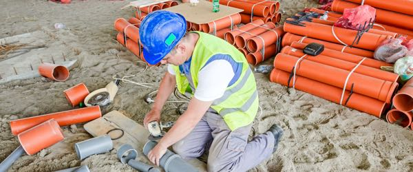 Pipelayers are the tradesmen who perform the initial groundwork for construction by laying down pipes that provide sewage disposal, drainage or water.
