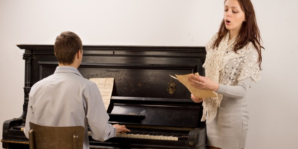 A piano accompanist is a musician who typically plays the piano at rehearsals or auditions for dancers, singers and other performers.