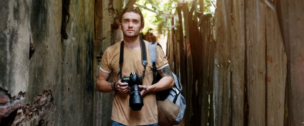 A photojournalist photographs, edits, and displays images in order to tell a visual story.