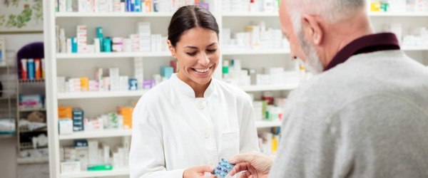 A pharmacist traditionally works in a pharmacy and is in charge of the dispensing of prescription medications.