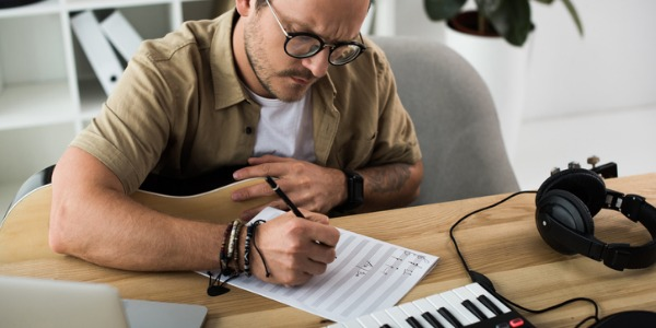 An orchestrator is someone who prepares music for an orchestra to perform.