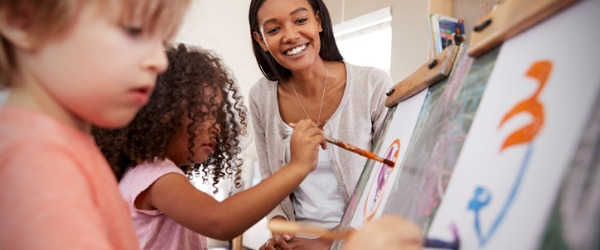 A kindergarten teacher is responsible for integrating young children into the world of learning by teaching them social skills, personal hygiene, basic reading skills, art, and music.