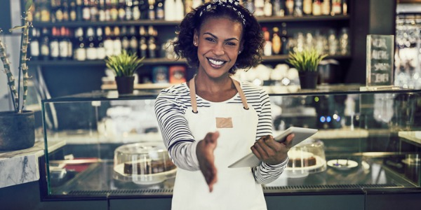 A hostess is someone who is responsible for greeting customers at a restaurant with a smile, welcoming them into the establishment, seating them, and providing them with a menu.
