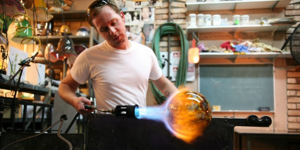 Glass jars and vases, jewelry, art work, and figurines all may emerge from the end of a narrow tube, the skill and tools of the glass blower determining the final shape of the glass.