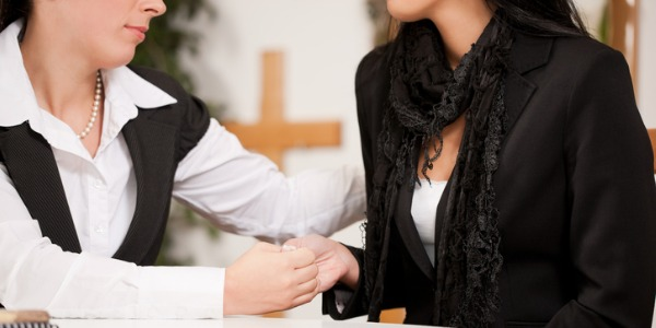 A funeral director manages a funeral home and arranges the details of a funeral.