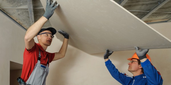 A drywall and ceiling tile installer is someone who hangs wallboards to walls and ceilings inside buildings.
