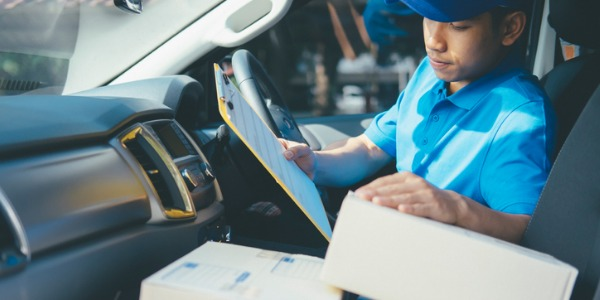 A delivery service driver picks up, transports, and drops off packages within a small region or urban area.