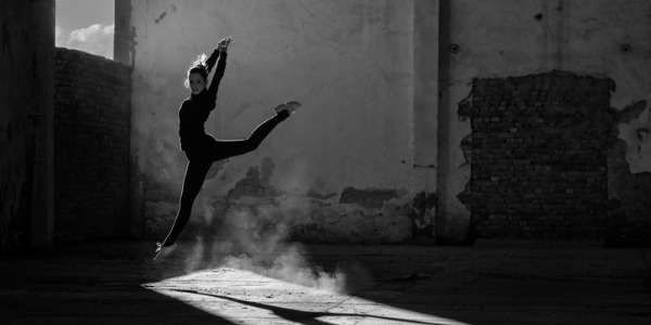 A dancer is someone who uses movements to express ideas and stories in performances.