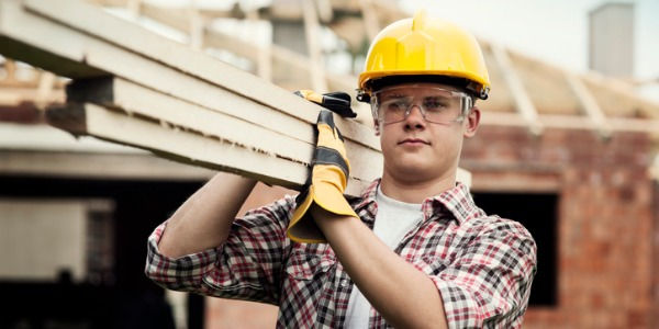 A construction worker does many basic tasks that require physical labour on construction sites.