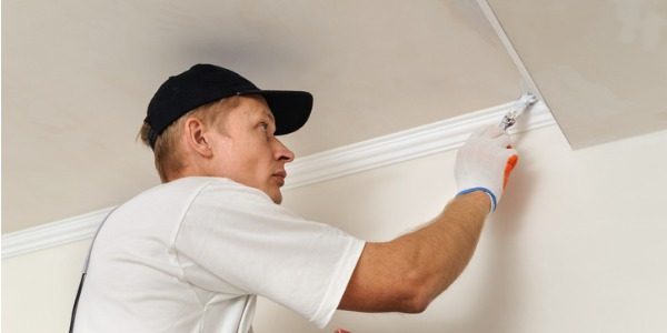 A construction painter is someone who applies paint, stain, and coatings to walls, buildings, bridges, and other structures.