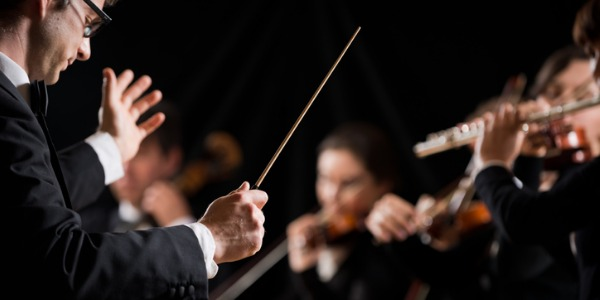 A conductor is a vital part of a music ensemble, acting as the director to keep the performers unified and on cue.