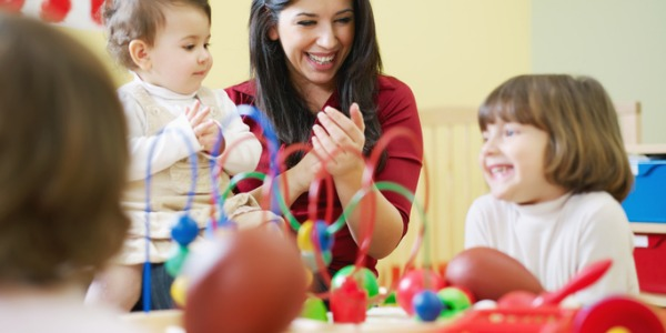 A childcare worker cares for children when parents and other family members are unavailable.
