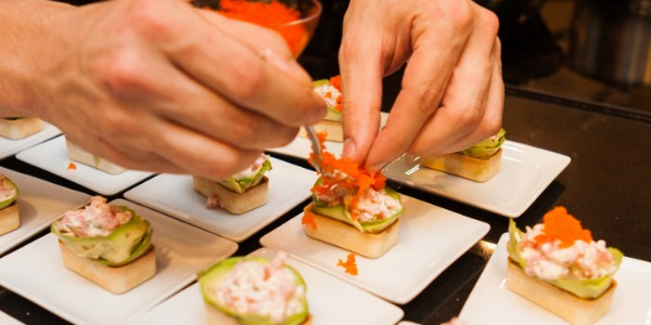 A caterer is someone who arranges the delivery, preparation and presentation of food for clients.