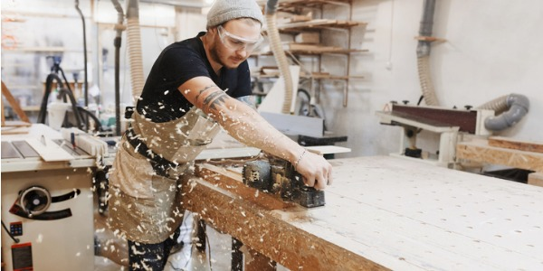 Carpenters are skilled craftsmen who work in the construction industry fabricating primarily wood constructions; from the entire framework of a building to ornate woodwork on stairs and trim.