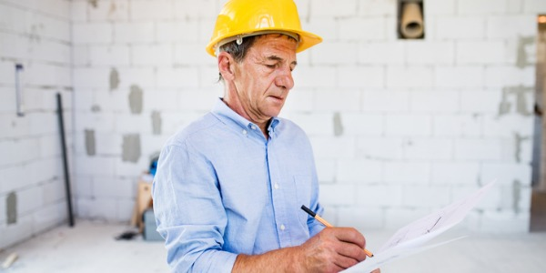 A building and construction inspector is employed by a city or township, and inspects buildings for the purpose of making sure they are safe to use.