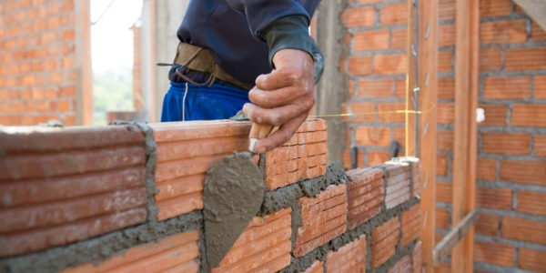 A brickmason uses bricks, concrete blocks, structural tiles, and natural and man-made stones to build walkways, fences, walls, patios, buildings, and other structures.