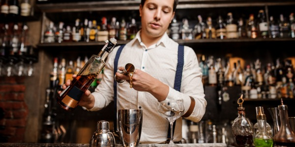 A bartender mixes and serves drinks to customers, either directly from patrons at the bar, or through wait staff who place drink orders for dining room customers.