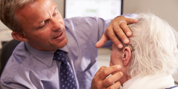 An audiologist uses audiometers, computers, and other devices to test patients' hearing ability and balance, determine the extent of hearing damage, and identify the underlying cause.
