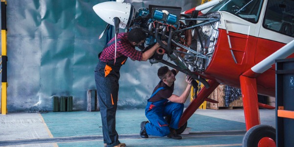 An aircraft mechanic is someone who repairs and performs scheduled maintenance on airplanes and helicopters.