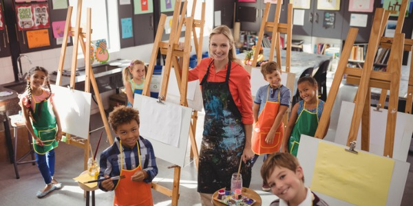 An art teacher typically works in the school system teaching students how to paint, draw, and create sculptures and ceramics.