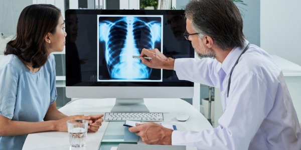 A radiologist explaining an X-ray.